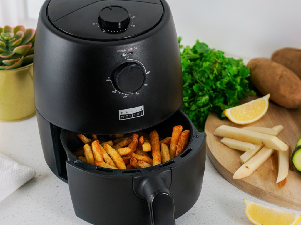 bella pro air fryer with french fries in the basket on a kitchen counter