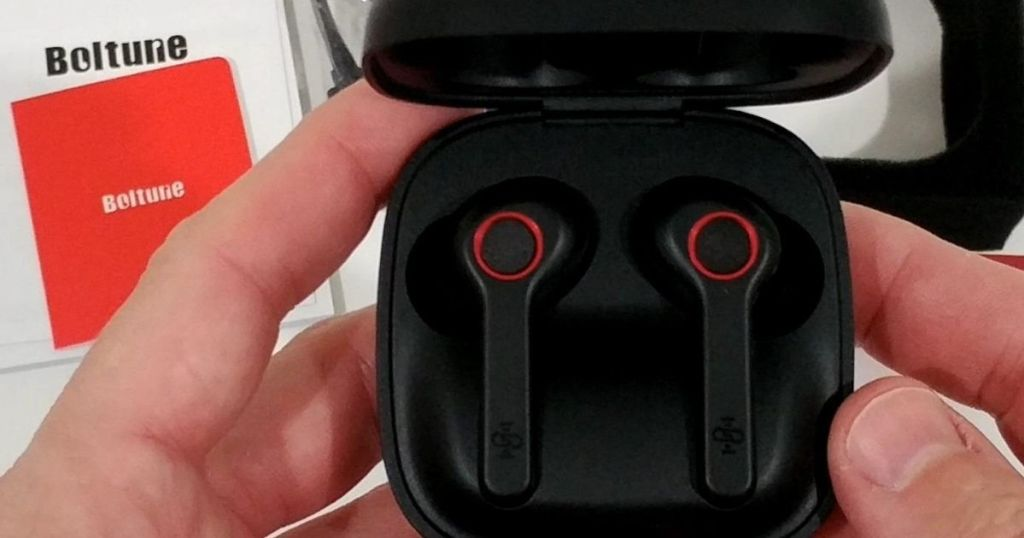 hands holding a pair of headphones