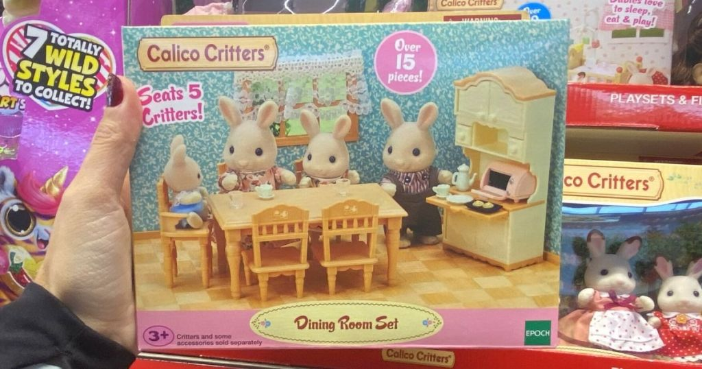 hand holding Calico Critters Dining Room Set
