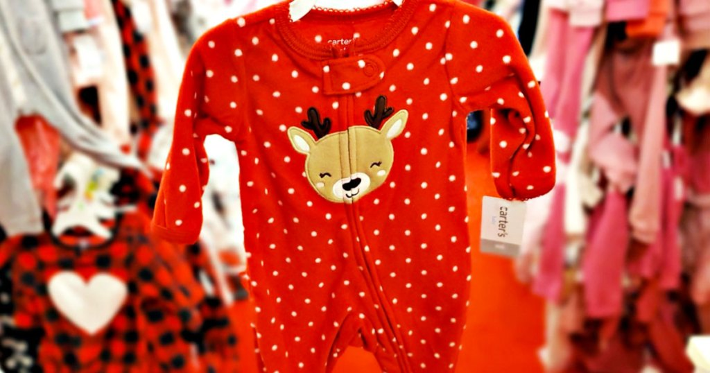 red polka dot baby onesie with a reindeer on it