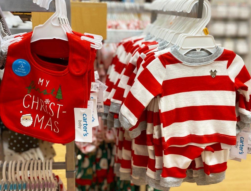 cater's baby first christmas bib and striped pajama set on display at store