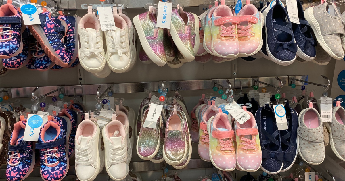 wall of carter's girls shoes in store
