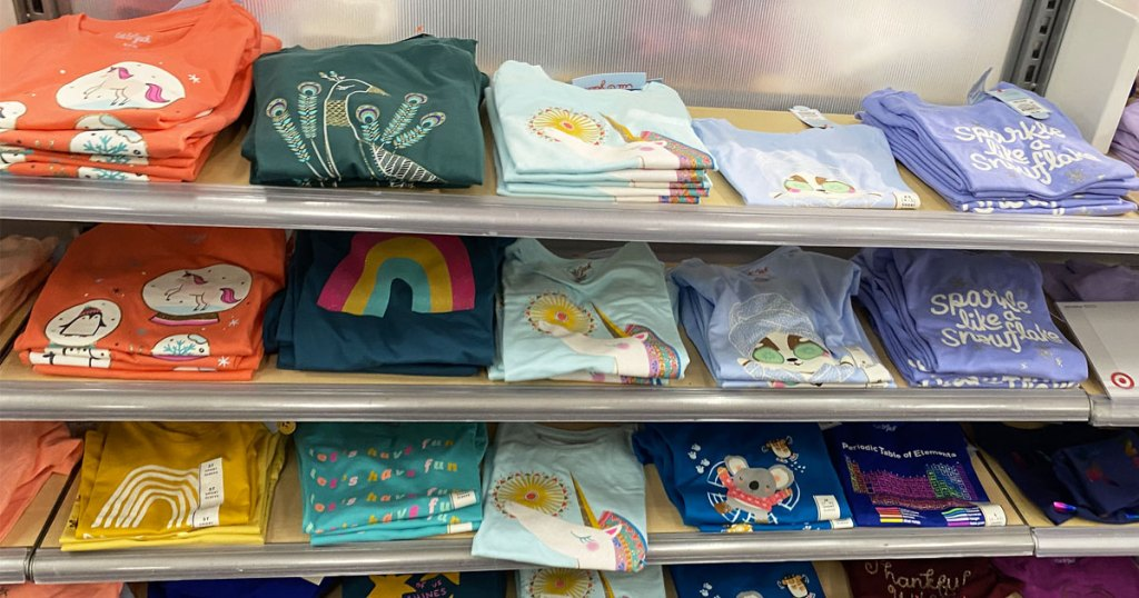 store display shelves full of girls cat & jack graphic tshirts