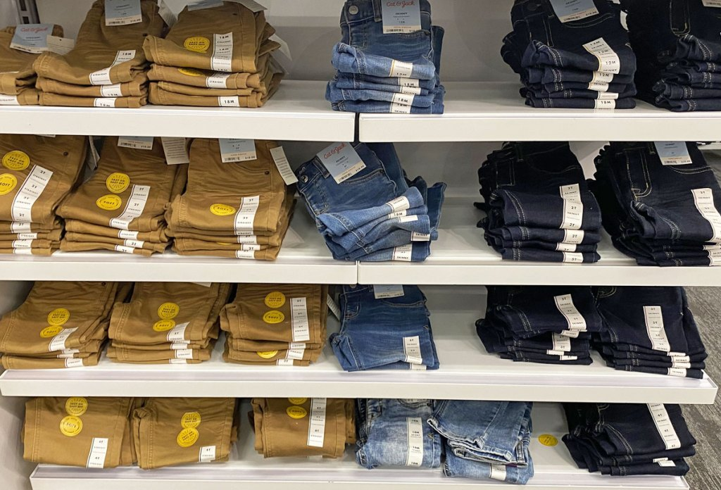 white display shelves full of folded pairs of cat & jack toddler boys pants and jeans