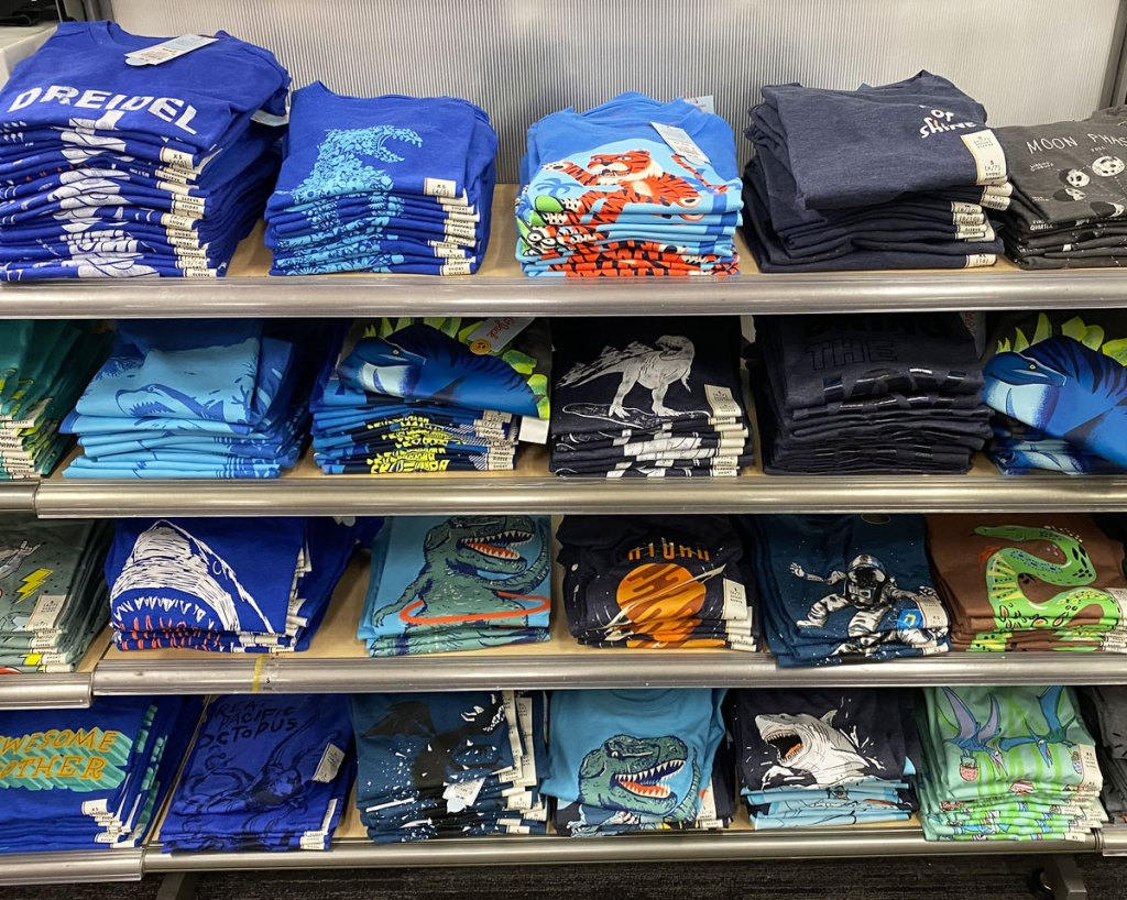 store display shelves full of folded toddler boys cat & jack graphic tees