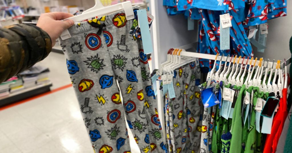 hand holding avengers pajama bottoms