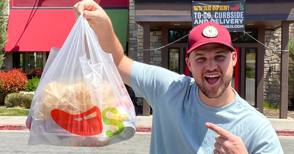 Man holding Chili's to go bag