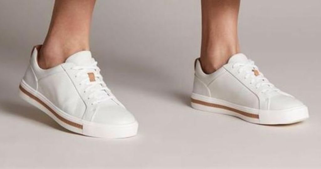 person wearing Clarks White Maui Sneakers