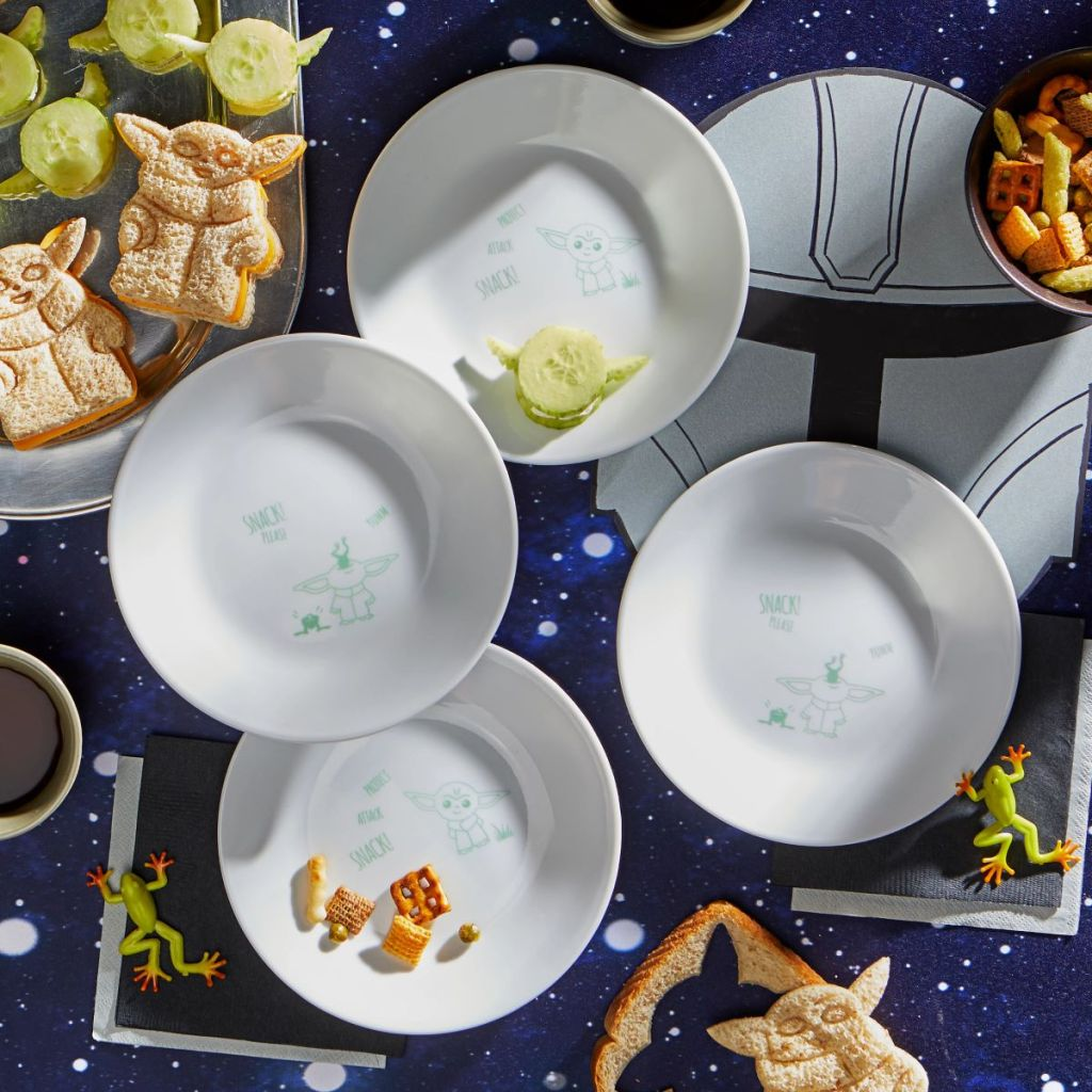 set of The Child plates on a table with Star Wars themed decorations