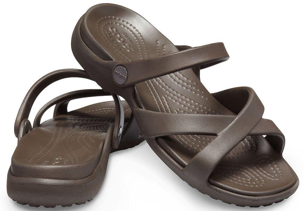 brown pair of Crocs Women's Meleen Cross-Band Sandal