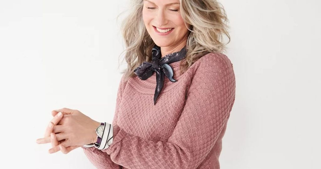 woman smiling wearing a sweater