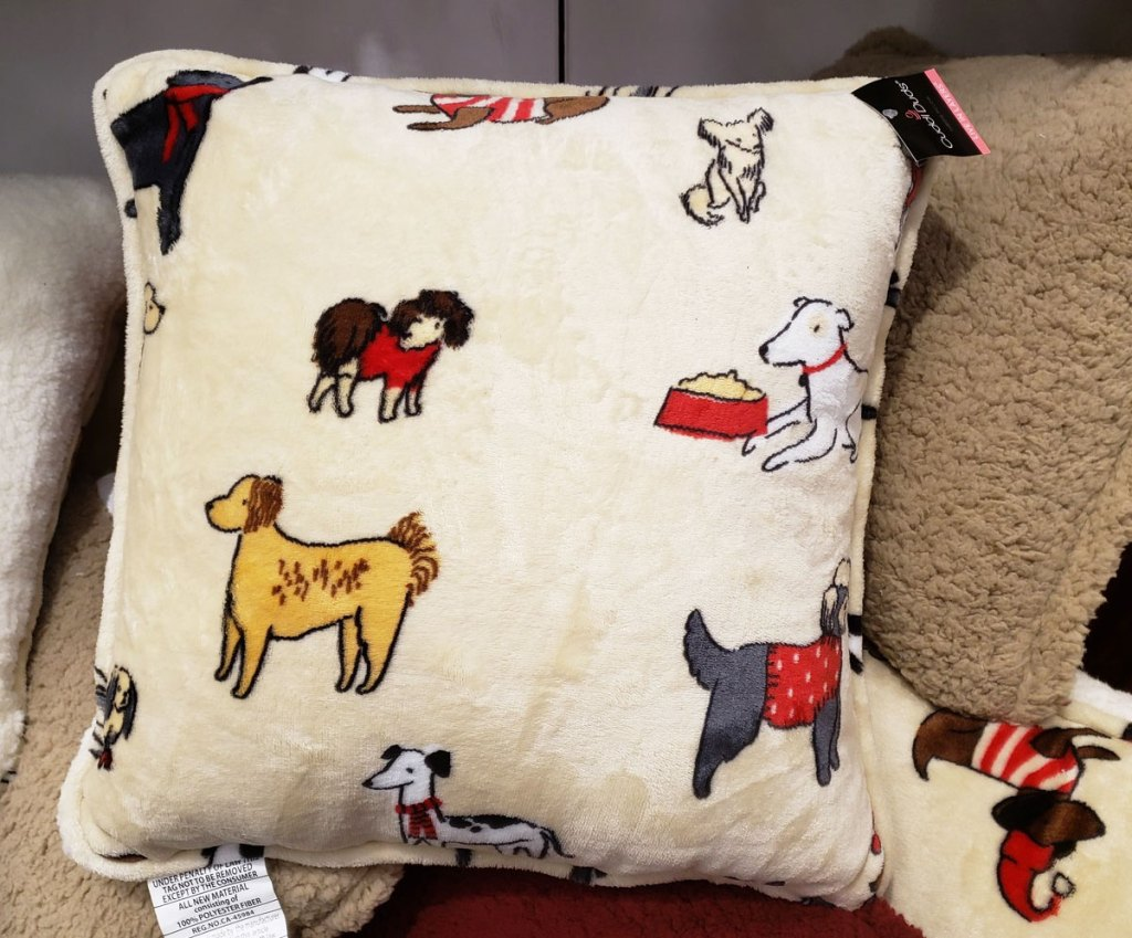 white velvet throw pillow with dogs printed on it