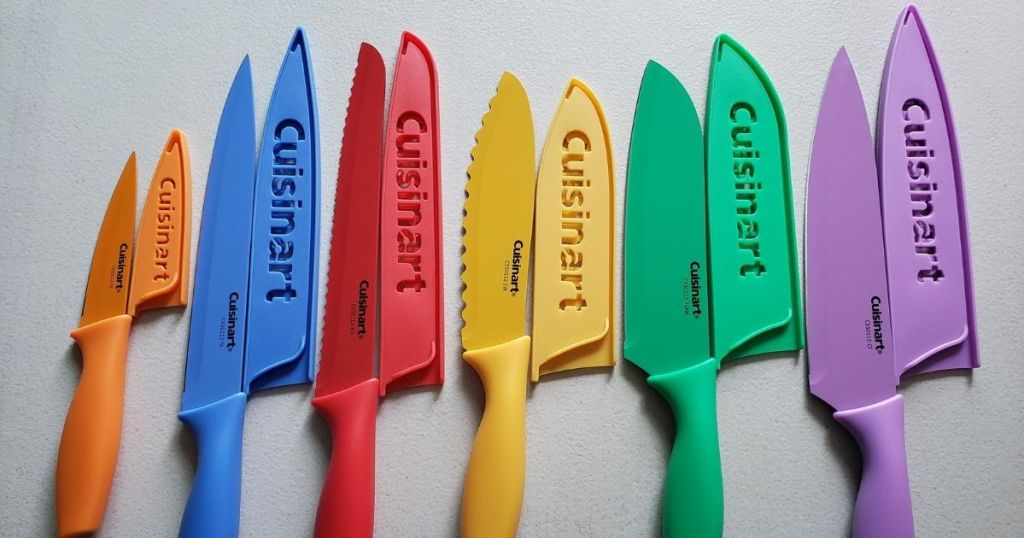 Cuisinart colorful knife set lined up with the guards next to the knives