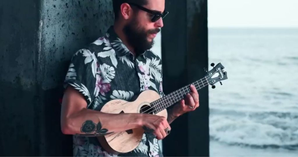 man playing D'Angelico Premier Series Bayside CS Concert Ukulele Natural