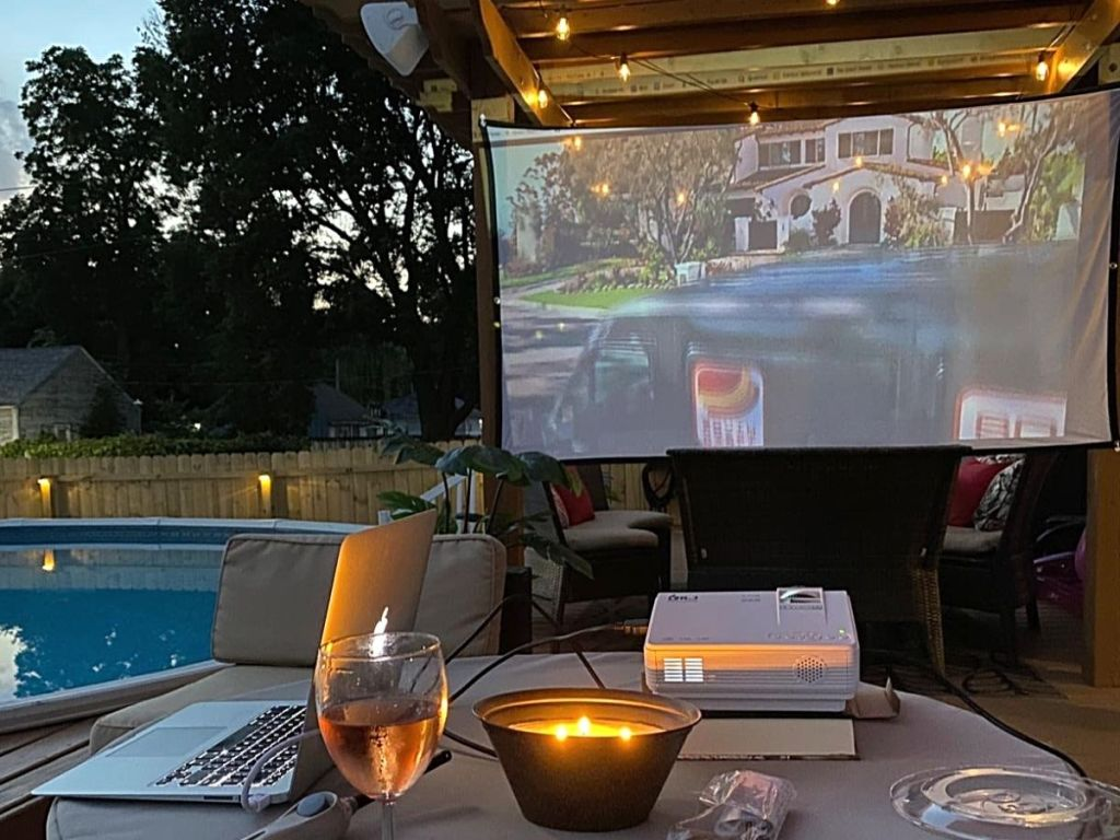 projector and screen with pool in background