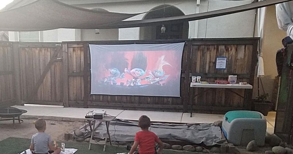 projector and screen with trolls movie playing