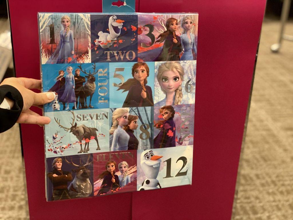 hand holding a Disney Frozen Accessories Advent Calendar