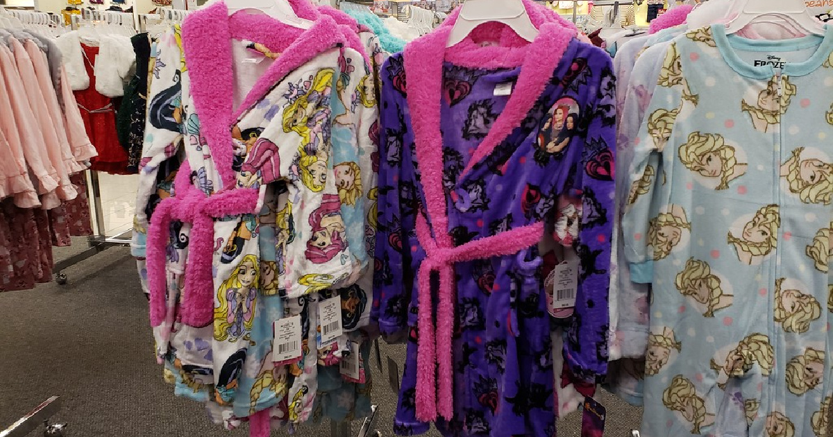 kids disney print robes on display in a store