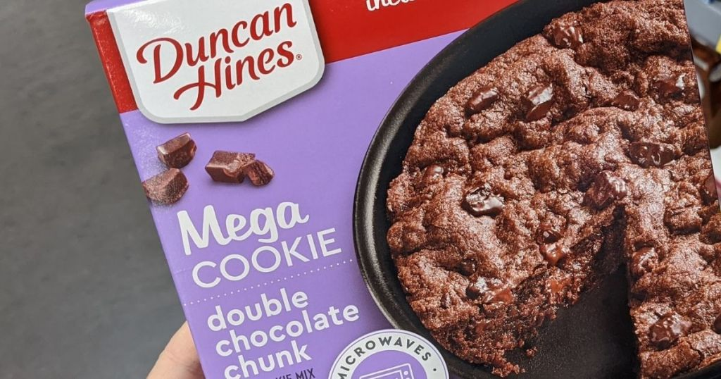 hand holding a Duncan Hines Cookie box