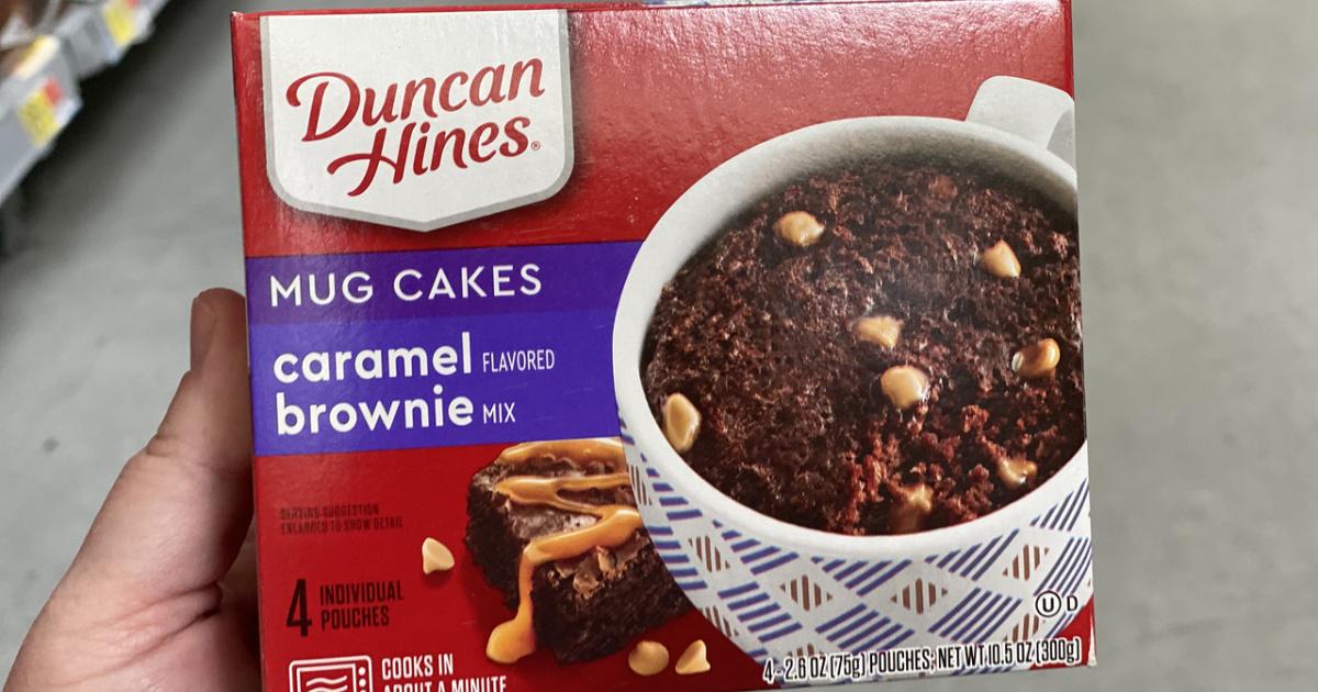 hand holding box of caramel brownie mug mix