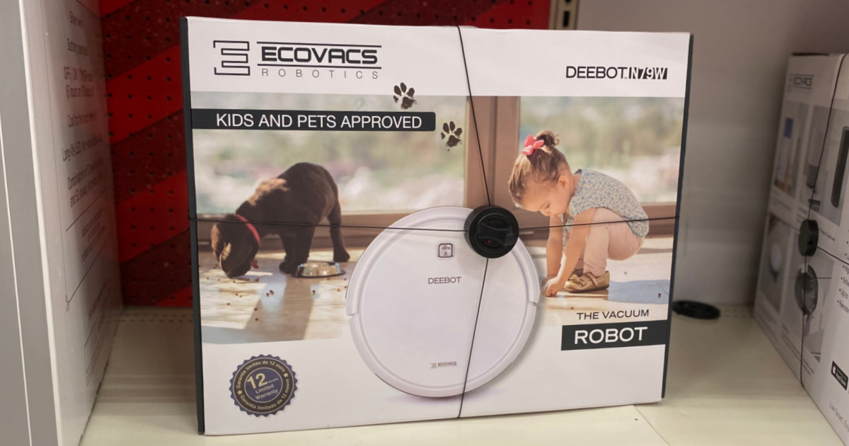 white robot vacuum on shelf