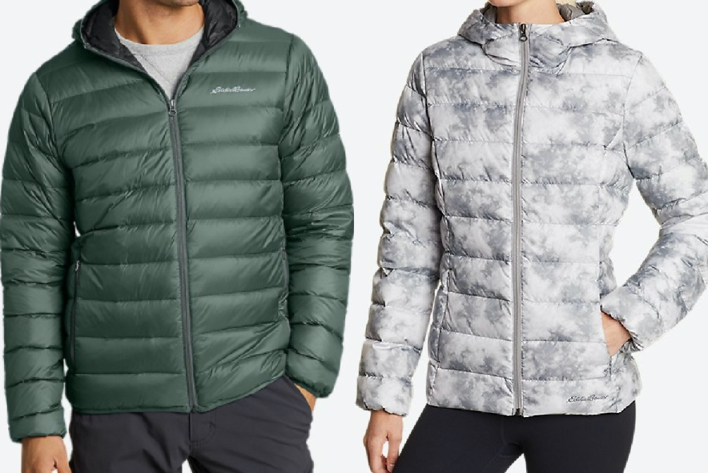 man in green hooded down jacket and woman in gray and white print hooded down jacket