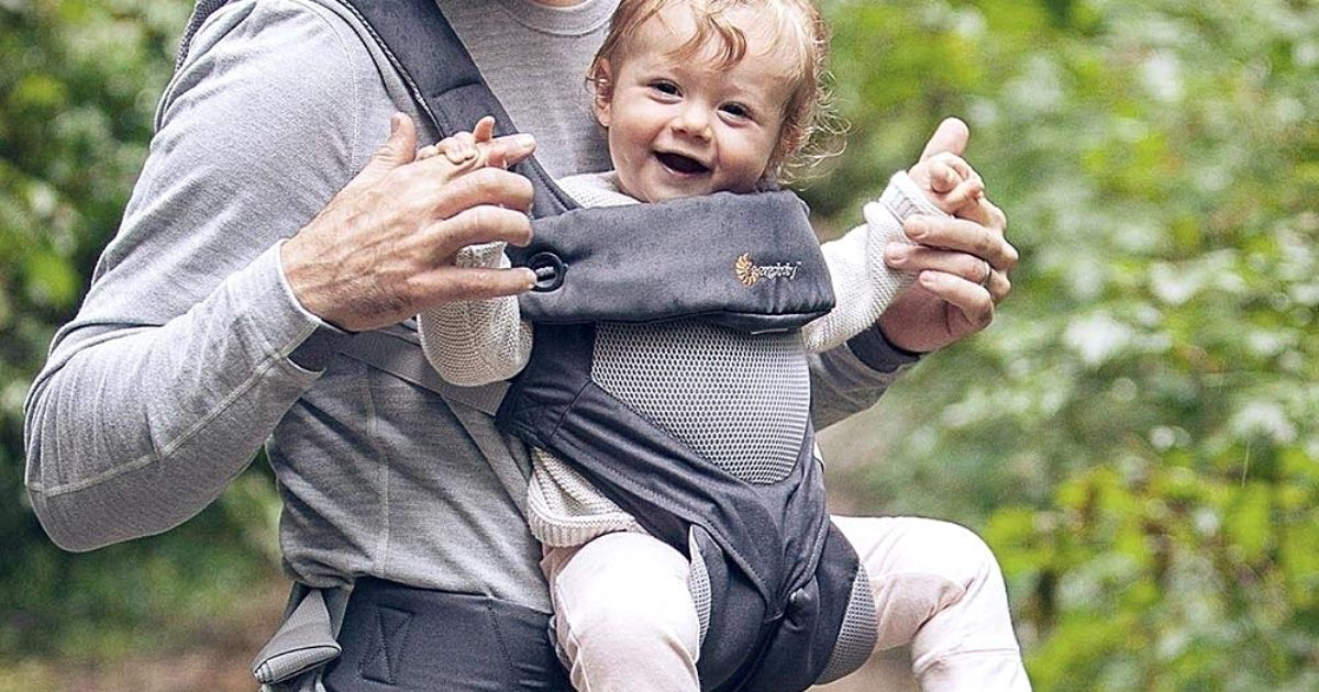 man wearing baby in ergobaby 360 baby carrier