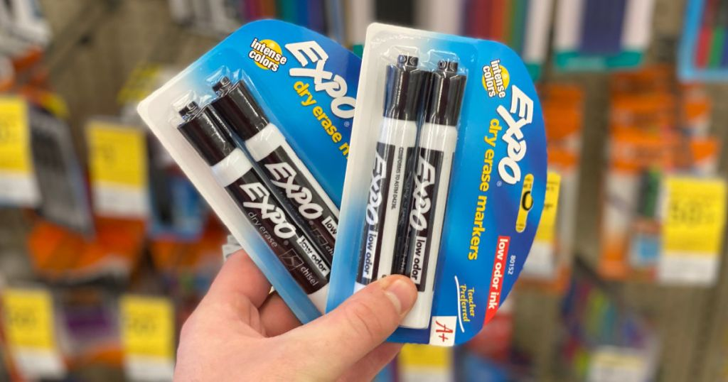 hand holding dry erase markers