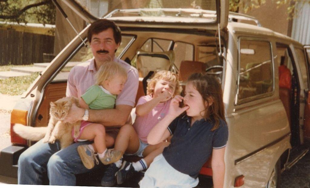 A family next to a car
