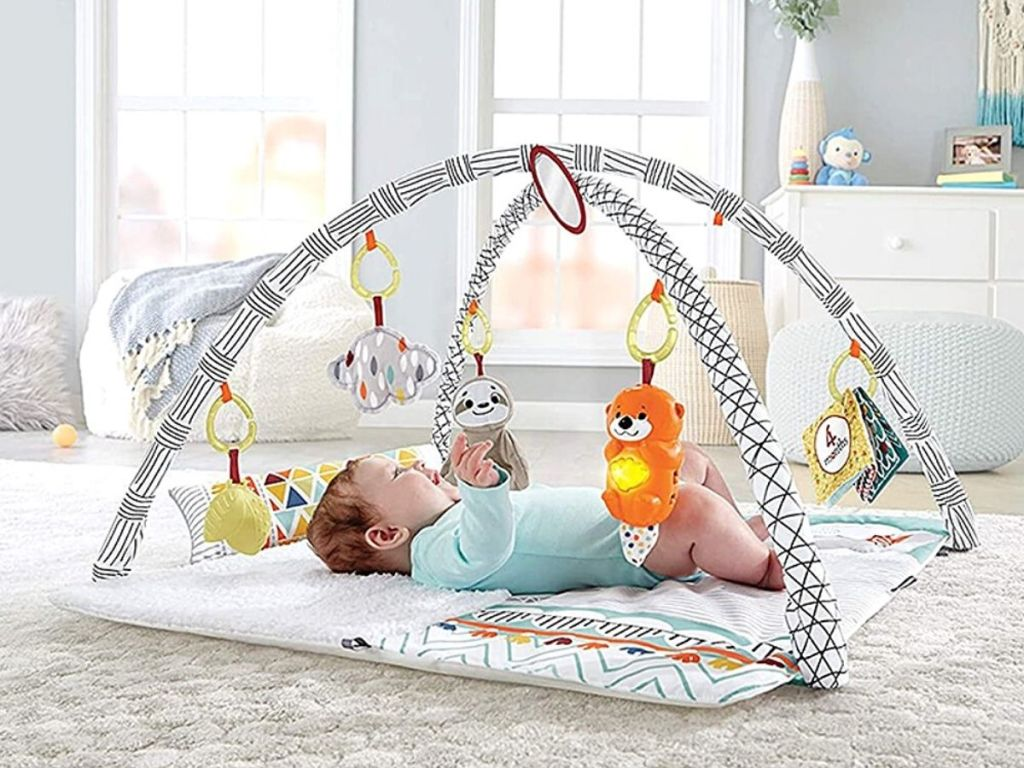 baby on back under baby gym