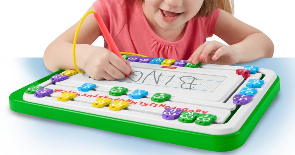 girl using toy slide writer