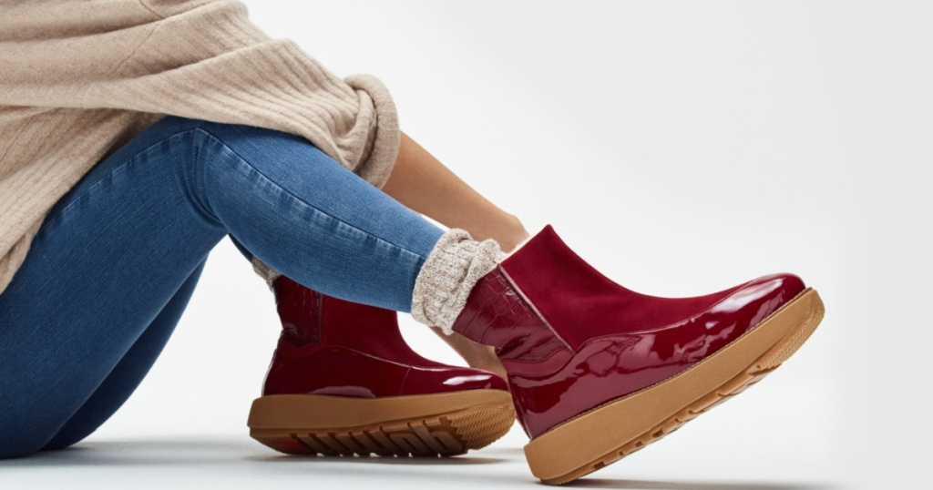 woman wearing maroon colored fitflop boots