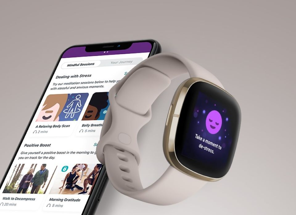 smartwatch next to a phone