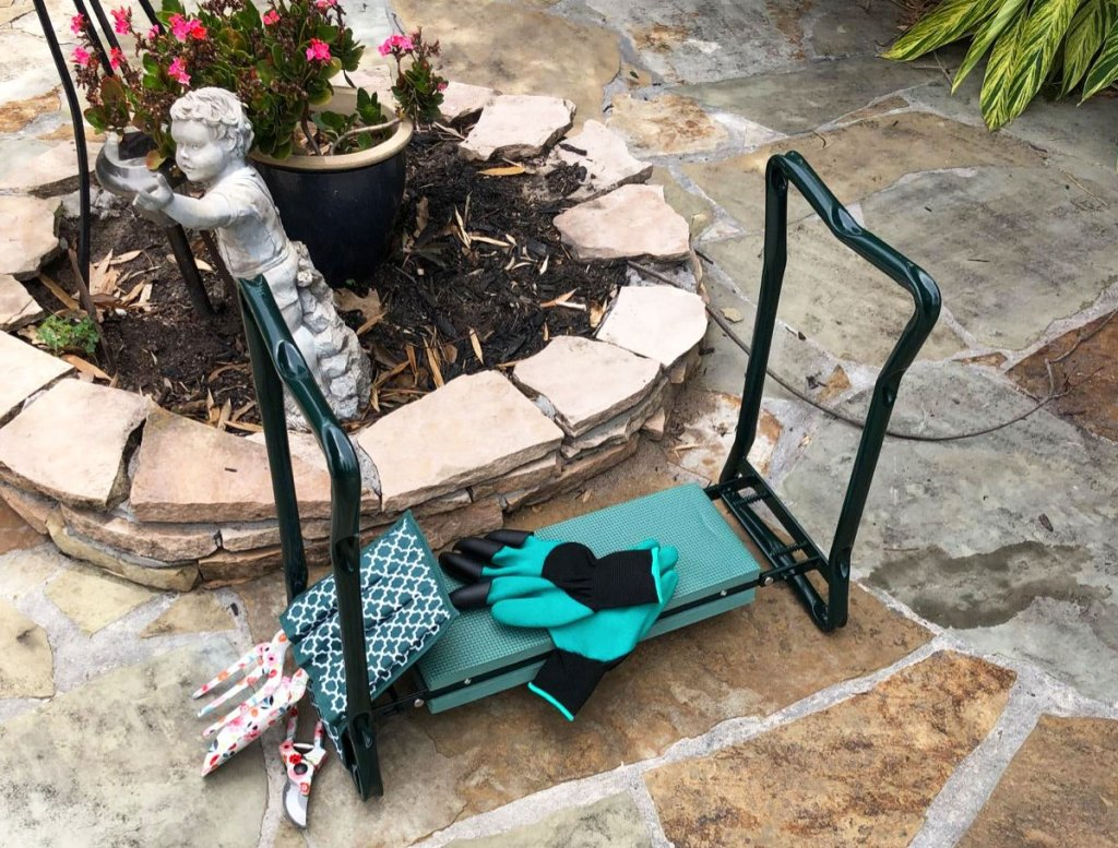 green kneeling stool with foam pad, gloves, and garden tools