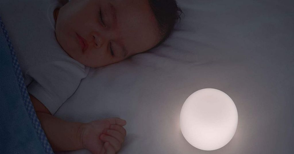 baby sleeping next to a nightlight