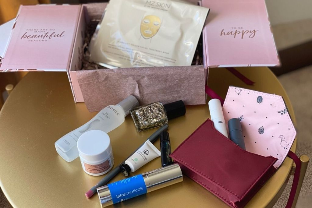 A variety of products from a GlossyBox on a table