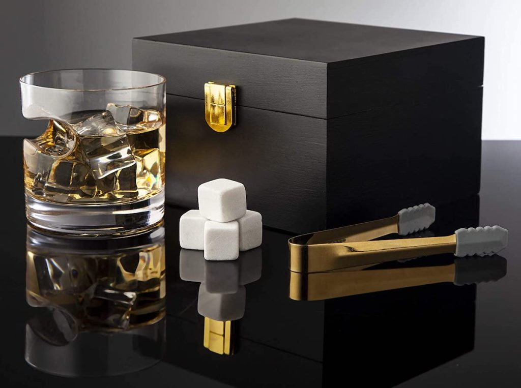 whisky glass with cigar indent, black gift box, and tongs