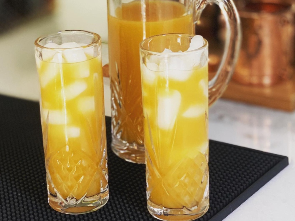 Godinger Tall Beverage Glasses with orange drinks inside