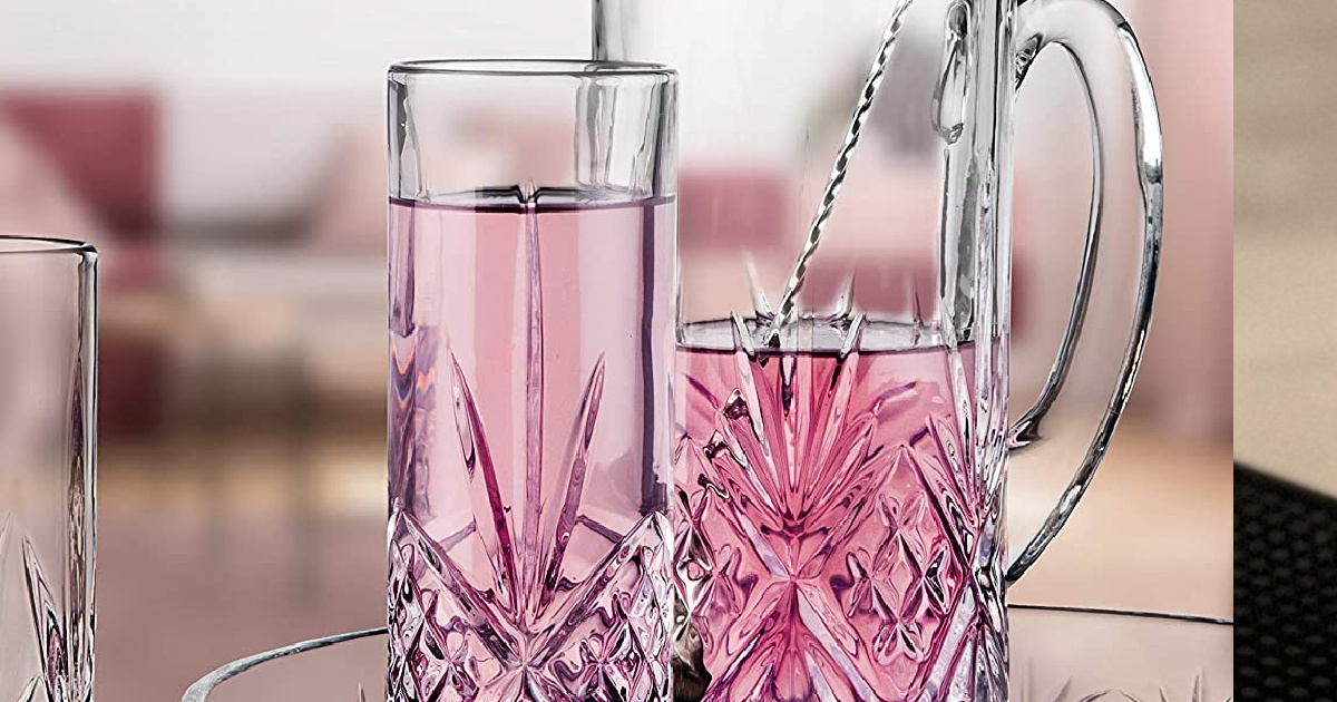 Godinger Tall Beverage Glass with pitcher and pink beverage inside