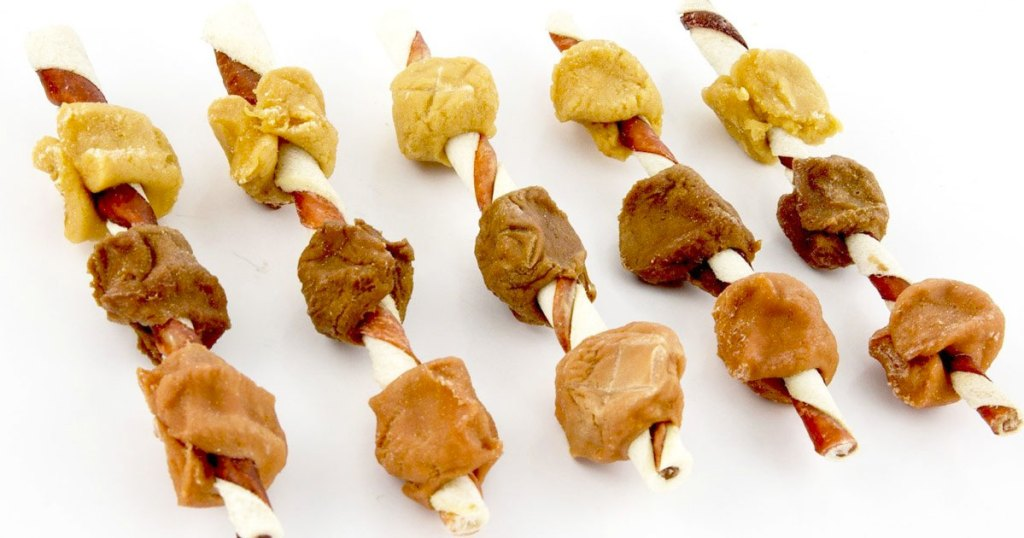 dog rawhide kabob treats with chunks of meat on them