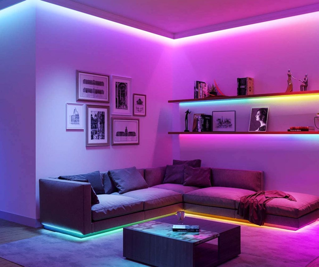led strip lights in a variety of colors around ceiling, book shelves, and under couch in a living room