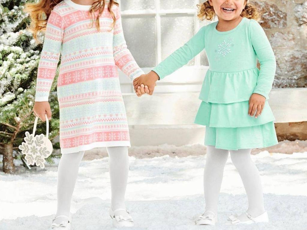 Two little girls wearing Gymboree girls dresses