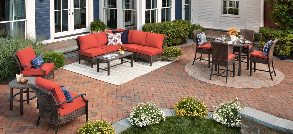 large patio with couch, table and chairs