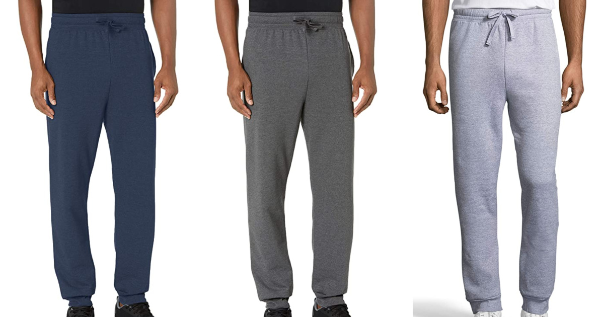 three men standing next to each other wearing hanes sweatpants
