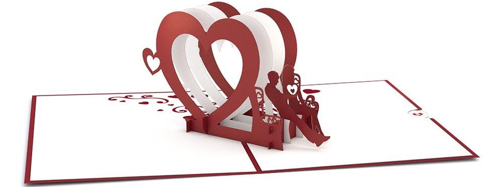 pop-up card with hearts and people on a bench