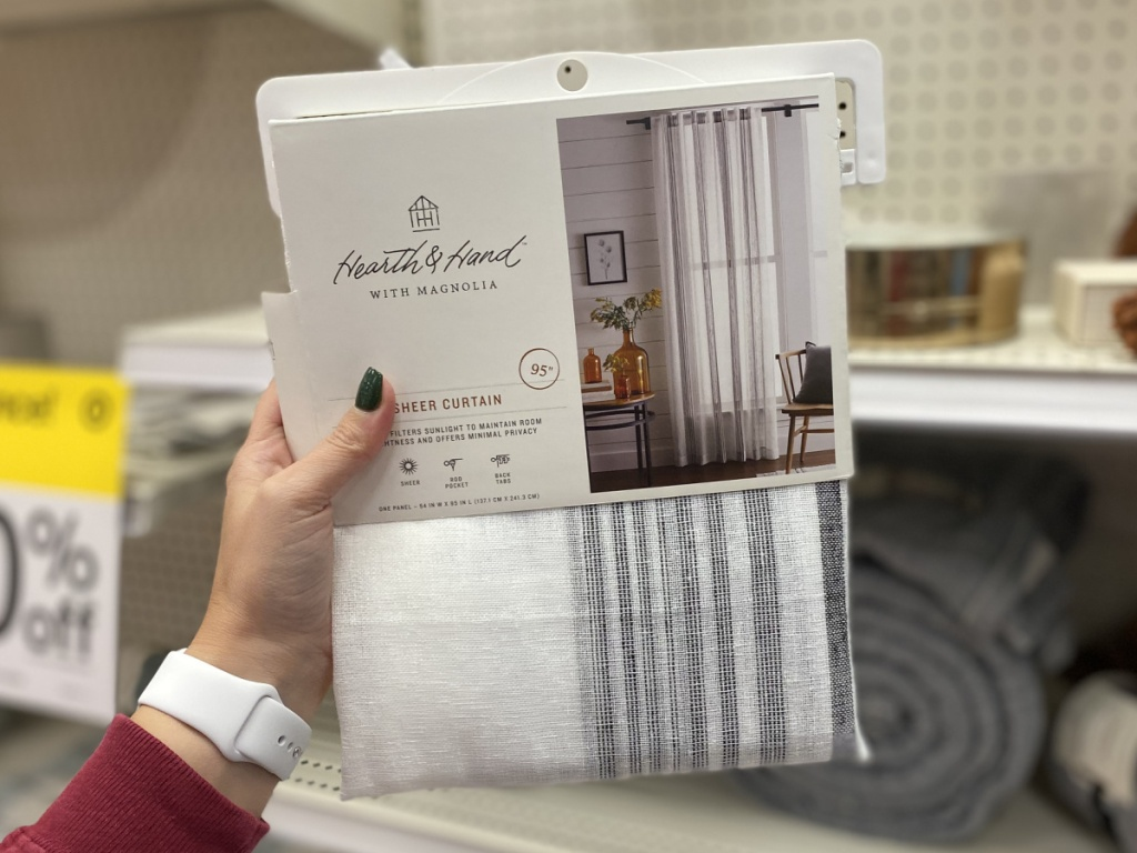 hand holding sheer hearth and hand curtain at target