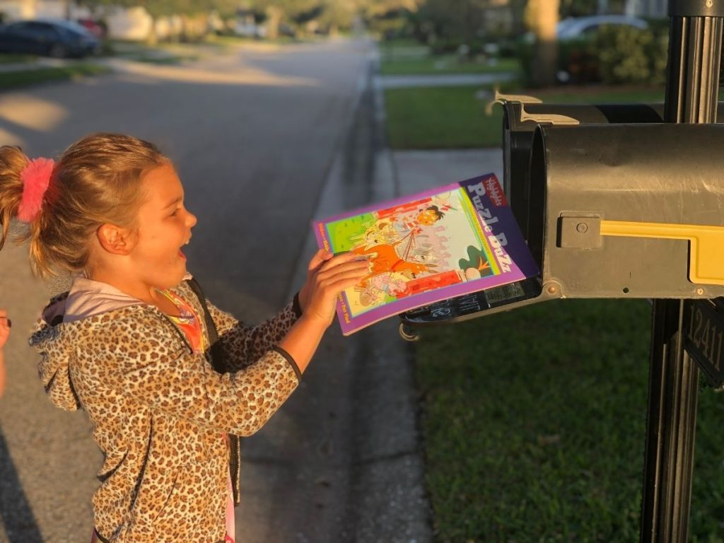 girl getting Highlights magazine out from mailbox