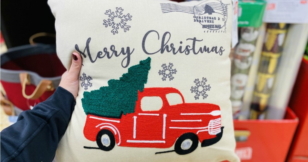 hand holding Holiday Decor Pillow from ALDI