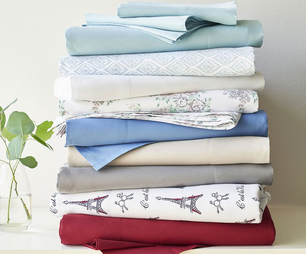 stack of folded sheets in various colors and prints