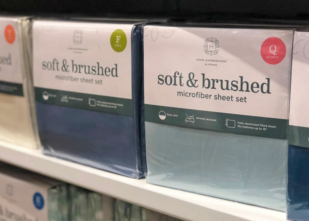 white store shelf full of sheet sets in various different colors